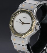 Cartier 'Santos'. Dameur i 18 kt. guld og stål med sølvfarvet skive, 1990'erne
