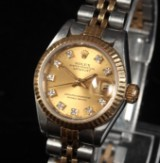 Rolex 'Datejust'. Dameur i 18 kt. guld og stål, brillantskive