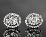 Pair of diamond ear studs in white gold, approx. 0.87 ct. (2)