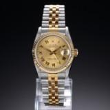 Rolex 'Datejust'. Midsize dameur i 18 kt. guld og stål med champagnefarvet skive, ca. 1991