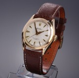 Rolex 'Oyster Perpetual'. Vintage men's watch, 18 kt. gold with pale dial, c. 1968