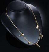 Dior. Halskæde af 18 kt. guld med 5 musikcharms. Vægt ca. 41,9 g