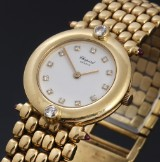 Chopard 'Classic'. Ladies watch, 18 kt. gold with diamonds and rubies, 1990s