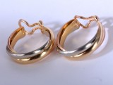 Cartier. Pair of Trinity clip-on earrings, 18 kt. gold (2)