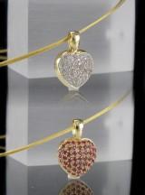 Vendevedhæng af guld med diamanter og rubiner