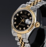 Rolex 'Datejust'. Ladies watch, 18 kt. gold and steel with black diamond dial, c. 1987
