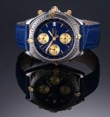 Breitling Chronomat. Herreur i 18 kt. guld og stål med blå skive, 1990'erne