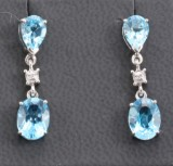 Diamond and topaz earrings in gold approx. 0.03ct