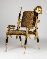 Rainer Weber, AK47 chair / throne, No.1, with helmet and munition belt, gold (3)