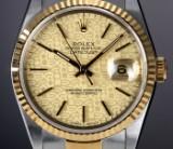 Rolex 'Datejust'. Herrenuhr aus 18 kt. Gelbgold und Stahl mit güldenem 'Logo' Zifferblatt, ca. 1989