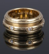 Piaget brillantring af 18 kt. guld med rotérbar centerring
