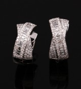 TIRISI. A pair of diamond earrings, 18 kt. white gold, total approx. 1.022 ct. (2)