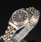 Rolex Datejust. Ladies watch, 18 kt. gold and steel with mother of pearl set wtih diamonds, 1998