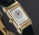 Jeager LeCoultre 'Reverso Duetto Lady'. Ladies watch, 18 kt. gold with diamonds
