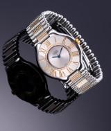 Cartier `Must de Cartier 21´. Dameur i stål prydet med safir, 1990'erne