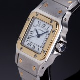 Cartier 'Santos Automatic'. Ladies watch, 18 kt. gold and steel with sapphire, 2000s