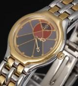 Omega De Ville `Symbol´. Dameur i 18 kt. guld og stål med usædvanlig skive, 1980´erne