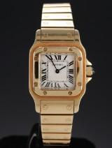 Cartier 'Santos Lady'. Dameur i 18 kt. guld med lys skive, 1990'erne