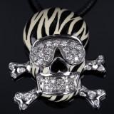 Oroluce Preziosi. Italian scull-shaped pendant, 18 kt. white gold with diamonds