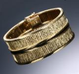Bred retroarmlænke af 14 kt. delvist satineret guld