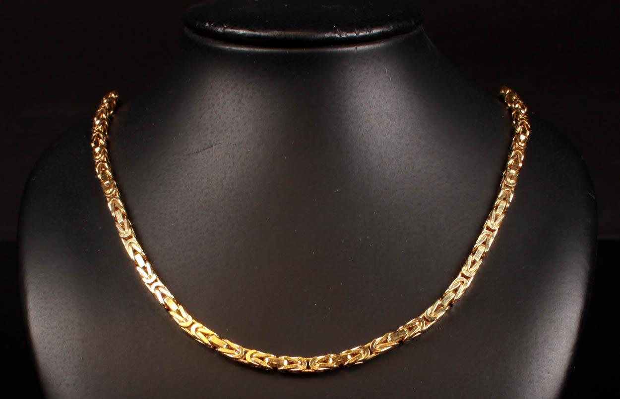 Italiensk kongehalskæde med facet, 18 kt guld - Italiensk kongehalskæde med facet af 18 kt guld monteret med kasselås og ottetals sikkerhedshaspe. L. 45,5 cm, B. 2,7 mm. Vægt 28,9 gram. Fremstår med brugsspor