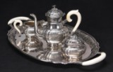 Axel Salomonsen. Large serving dish, coffee pot, sugar and cream containers in sterling silver (4)