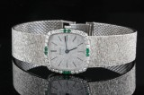 Piaget diamond and emerald mechanical wristwatch in 18kt  approx. 0.60ct.