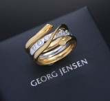Georg Jensen. 'Magic' ring, 18 kt. yellow and white gold, with diamonds