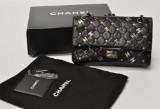 Chanel. Handbag, black quilted lambskin