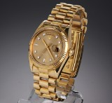 Rolex Day-Date. Men's watch, 18 kt. gold with champagne-coloured dial, 1973