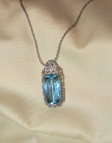 Platinum and white gold necklace featuring diamonds and one aquamarine