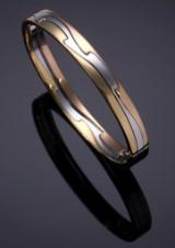 Nina Koppel for Georg Jensen. 'Fusion' bangle, gold, white gold and rose gold, 18 kt.