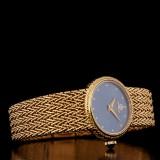 Baume Mercier damarmbandsur i 18 k guld