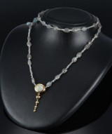 Ole Lynggaard. 'Emeli' clasp, 18 kt. gold with moonstone with key pendant and 3 necklaces (5)