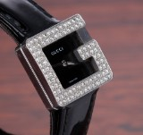 Gucci 'G'. Ladies watch, steel with diamonds, black dial, 2000s