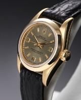 Rolex 'Oyster Pepetual'. Dameur i 18 kt. guld med gylden skive, ca. 1991