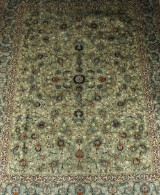 A Persian hand-knotted carpet, Kashan, 395x320 cm