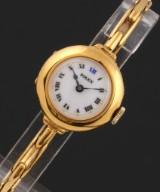 Rolex. Vintage ladies watch, 18 kt. gold with white enamel dial, c. 1934