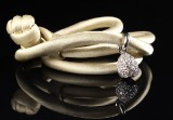 Ole Lynggaard. Charm, Sweet Drops, with beige silk cord, 18 kt white gold
