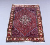 Persisk bidjar tæppe. 175 x 119 cm.
