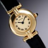 Cartier 'Colisee'. Dameur i 18 kt. guld med champagnefarvet skive, 1990'erne