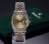 Rolex 'Datejust'. Men's watch, 18 kt. gold and steel with champagne-coloured dial, c. 1977