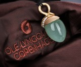 Ole Lynggaard. 'Lotus' pendant, 18 kt. red and rose gold, with grey moonstone and diamonds