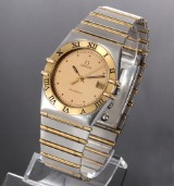 Omega Constellation. Men's watch, 18 kt. gold and steel, with date