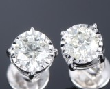 Diamond solitaire earrings, 18 kt. white gold, total approx. 2.03 ct. (2)