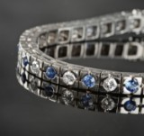 White gold bracelet featuring brilliant-cut diamonds and sapphires
