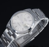 Rolex Date. Men's watch, steel with silver-coloured dial with date, certificate 1990