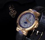 Corum 'Meteorite Moonphase Admiral Peary'. Men's watch, 18 kt. gold with meteorite dial