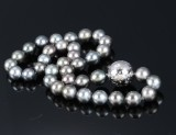 A Tahitian cultured pearl necklace with a large diamond ball clasp