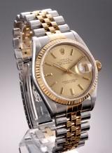Rolex 'Datejust'. Herreur i 18 kt. guld og stål med champagnefarvet skive, ca. 1976